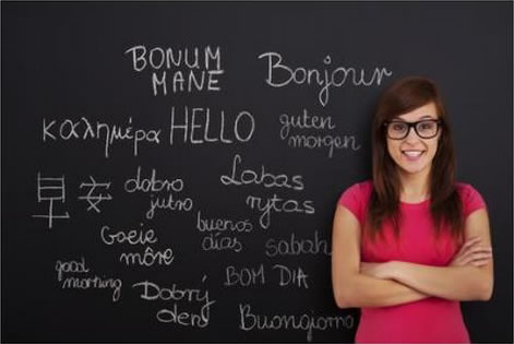 Blackboard with various languages writing on it, courtesy of Shutterstock