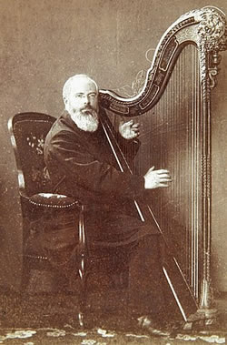 Johann Martin Schleyer playing the harp in 1888